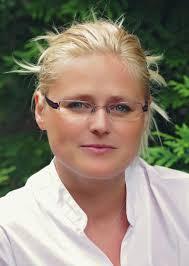 Zdjęcie portretowe przedstawia dr Joannę Sztobryn-Giercuszkiewicz